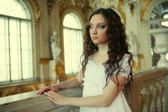Beautiful young victorian lady in white dress stock photos