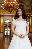 Beautiful young victorian lady in white dress. Portrait of a beautiful young victorian lady in white dress.Russian palace Stock Image