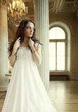beautiful young victorian lady in white dress Stock Images