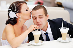 Beautiful young wedding couple  drinking cappuccino. Stock Images