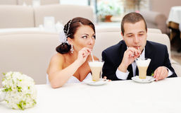 Beautiful young wedding couple  drinking cappuccino. Stock Photography