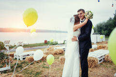 Beautiful young wedding couple kissing , blonde bride with flowe Royalty Free Stock Photo