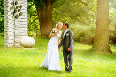 Beautiful young wedding couple kissing Stock Photo