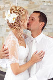 Beautiful young wedding couple kissing Stock Photography