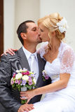 Beautiful young wedding couple kissing Royalty Free Stock Photo