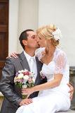 Beautiful young wedding couple kissing Royalty Free Stock Image