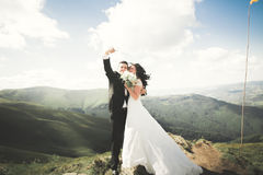Beautiful young wedding couple making selfie on the background of mountains royalty free stock photography