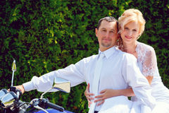 Beautiful young wedding couple on motorcycle Royalty Free Stock Photography