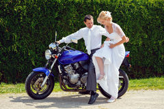 Beautiful young wedding couple on motorcycle Royalty Free Stock Image
