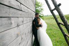 Beautiful young wedding couple outdoors Royalty Free Stock Photography