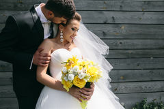 Beautiful young wedding couple outdoors Stock Photography