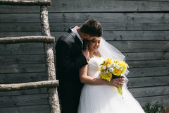 Beautiful young wedding couple outdoors Royalty Free Stock Image