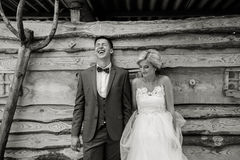 Beautiful young wedding couple stands near house Royalty Free Stock Photography