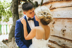 Beautiful young wedding couple stands near house Royalty Free Stock Photos