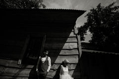 Beautiful young wedding couple stands near house Stock Image