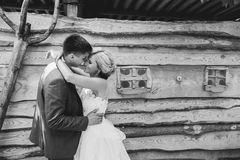 Beautiful young wedding couple stands near house Royalty Free Stock Image