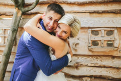 Beautiful young wedding couple stands near house Royalty Free Stock Images