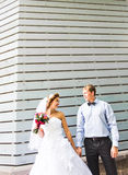 Beautiful young wedding couple stands near the old Royalty Free Stock Photos