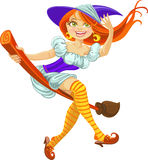 Beautiful young witch on a broomstick in the air Stock Photo
