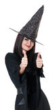 Beautiful young witch Stock Image