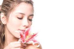 Beautiful young woman. Contemplating a flower Royalty Free Stock Image