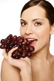Beautiful young woman. With grape Stock Images