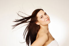 Beautiful young woman. Portrait of a beautiful young woman with hair flying Royalty Free Stock Images