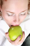 Beautiful young woman. Eating green apple stock photos