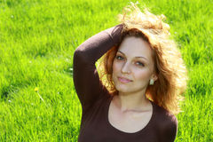 Beautiful young woman. Relaxing in the grass royalty free stock images