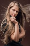 A beautiful young woman. With long hair stock photography