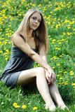 Beautiful young woman. Relaxing in the grass Royalty Free Stock Photo
