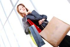 Beautiful young woman. In shopping Stock Image