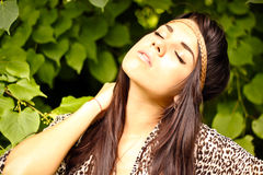 Beautiful young woman. Resting outdoors royalty free stock image