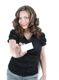 Beautiful young woman. Young business woman with business card on a white background royalty free stock photo