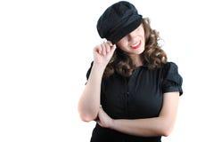 Beautiful young woman. Portrait of beautiful girl in black cap posing on white stock photo