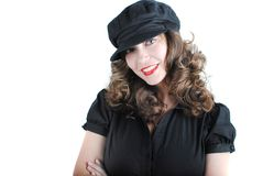Beautiful young woman. Portrait of beautiful girl in black cap posing on white stock photos
