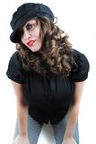 Beautiful young woman. Portrait of beautiful girl in black cap posing on white stock images
