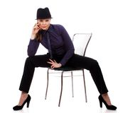 Beautiful young woman. Posing on a chair Stock Photos