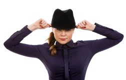 Beautiful young woman. Holding hat Stock Photo