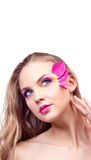 Beautiful young woman. With creative makeup with tulip petals, looking up; a lot of copy space for your text above her Royalty Free Stock Images