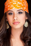 Beautiful Young Woman. Beautiful and exotic young mixed race woman wearing a colorful bandanna on a black background Stock Photography
