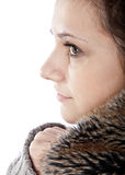 Beautiful young woman. In fur-lined coat on white background Royalty Free Stock Photos