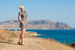 Beautiful young woman. Near the sea royalty free stock images