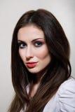 Beautiful young woman. Closeup portrait of a beautiful young woman isolated on gray background Royalty Free Stock Photos