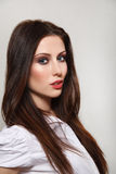Beautiful young woman. Closeup portrait of a beautiful young woman  on gray background Stock Image