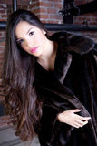 Beautiful Young Woman. With long hair wearing a Faux fur coat Royalty Free Stock Photos