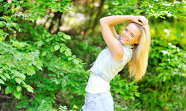 Beautiful young woman. Posing outdoors royalty free stock image