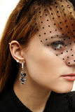 Beautiful Young Woman. With veil and earrings Royalty Free Stock Images