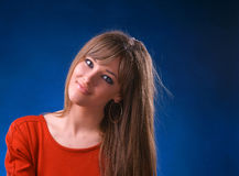 Beautiful young woman. On a blue background stock image