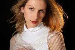 Beautiful young woman. Magic look Stock Photos